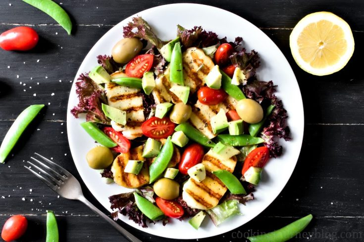 Grilled Halloumi and Avocado Salad, served on a plate