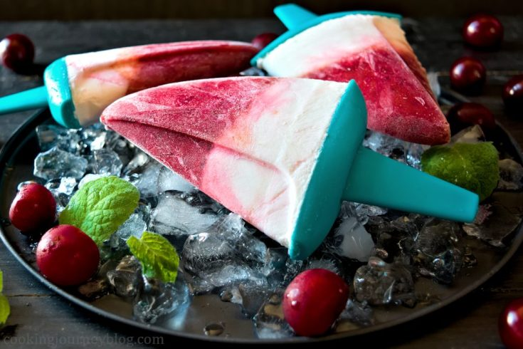 Homemade sugar free popsicles, served with ice, mint and cherries for three persons