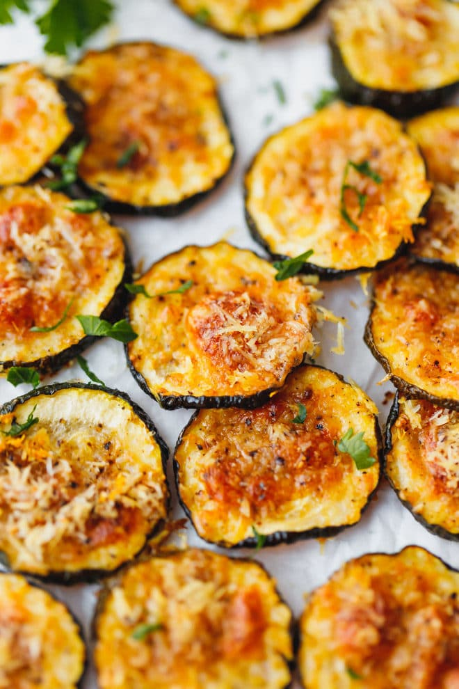 Baked Zucchini Chips on parchment paper