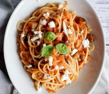 plate of spaghetti with tomato sauce and mozzarella