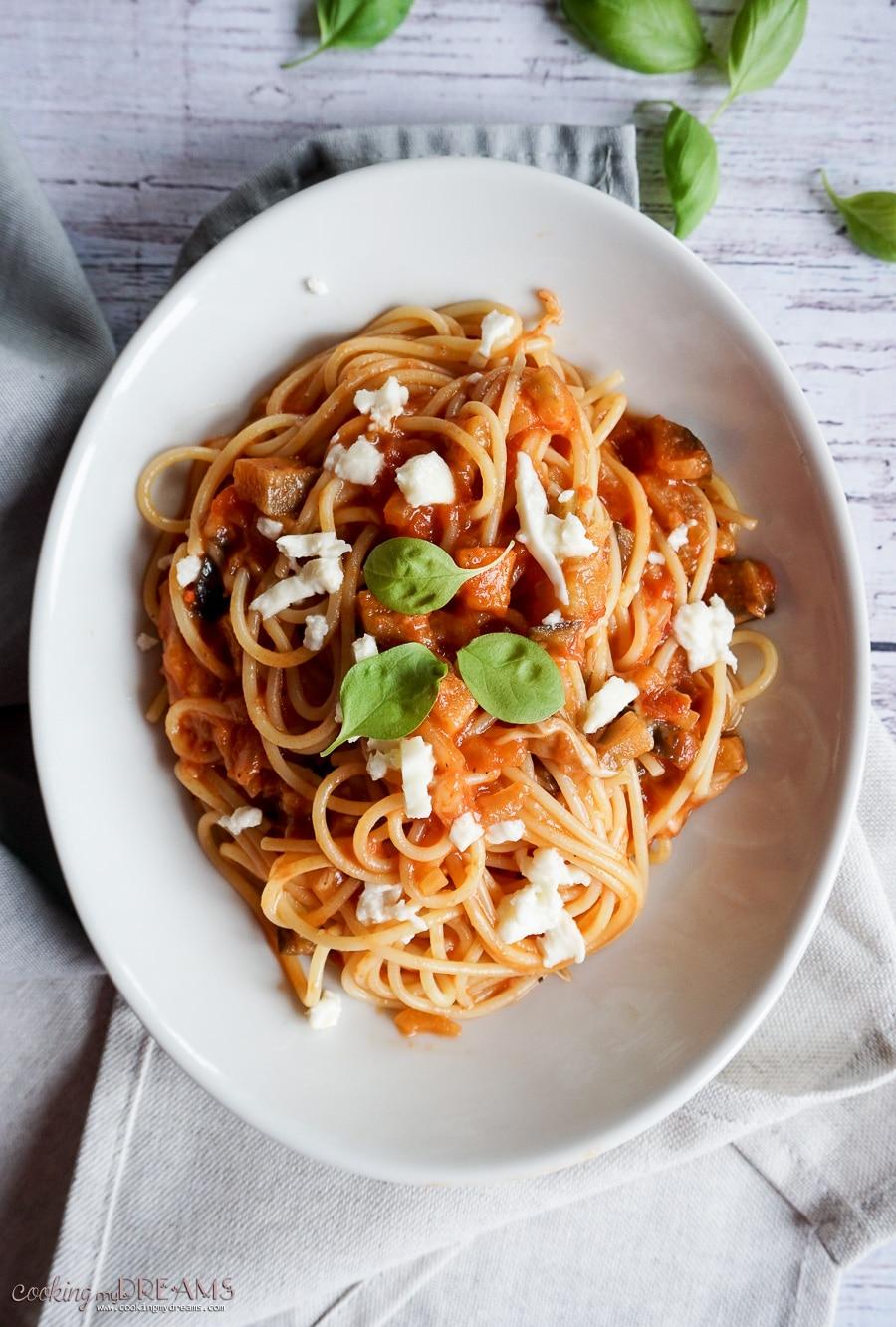 plate of spaghetti with tomato sauce and mozzarella