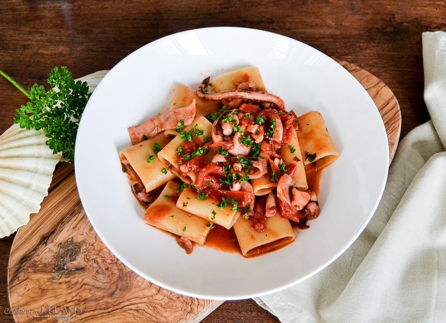 calamarata pasta with squids and tomato sauce