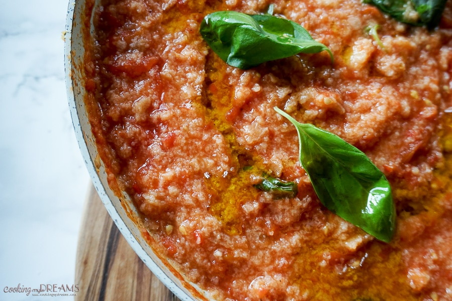 pan of italian bread and tomato dish pappa al pomodoro with basil