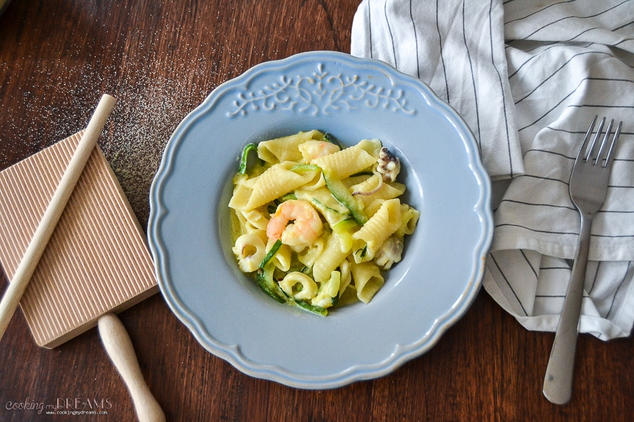 homemade garganelli pasta with seafood and zucchini