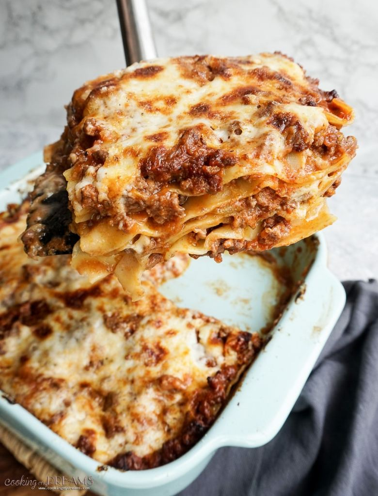 spatula taking up a portion of classic lasagna