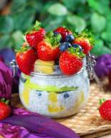 Overnight chia pudding with strawberries, blueberries and pineapple