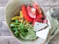 tomato salad with avocado cream and feta cheese