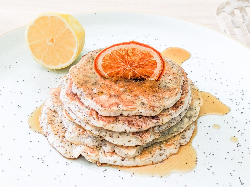 lemon and poppy seed pancakes with lemon maple syrup