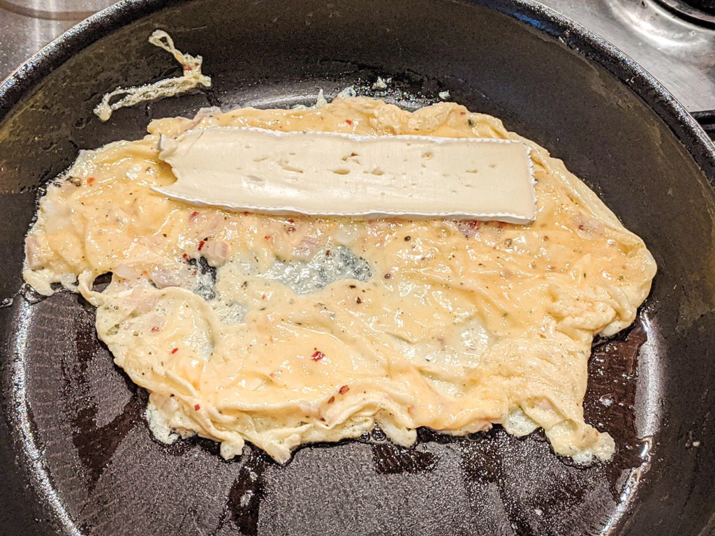 Add the brie to the top of the pan