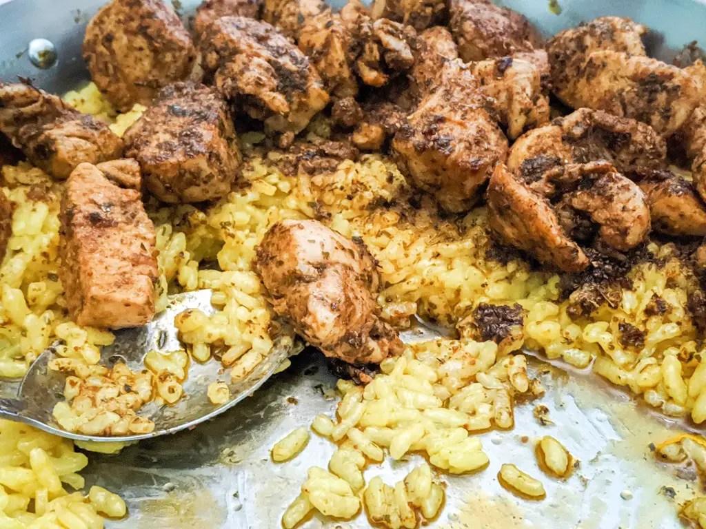 Khmeli Suneli Chicken on Saffron Rice in a paella dish