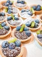 Chocolate hazelnut tartlets with fruit and powdered sugar