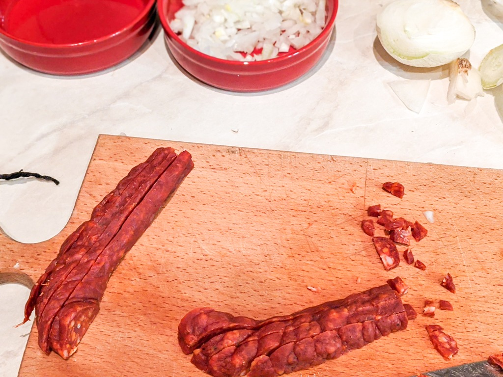chopping the Spanish chorizo