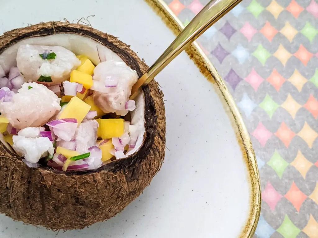 Mango coconut ceviche in a coconut bowl