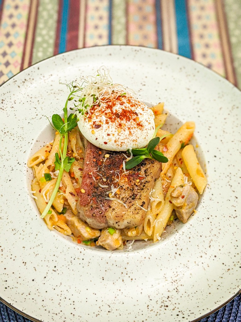 Picture of the recipe for penne pasta with pork belly and poached egg