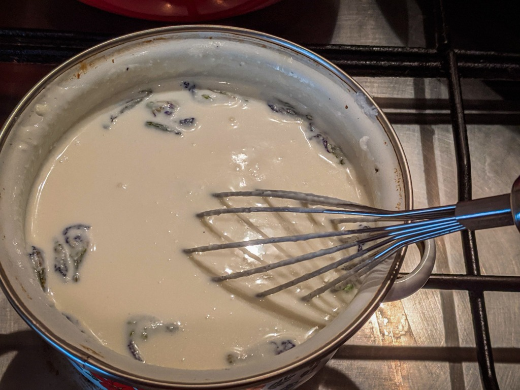 boiling the cream and ricotta cheese