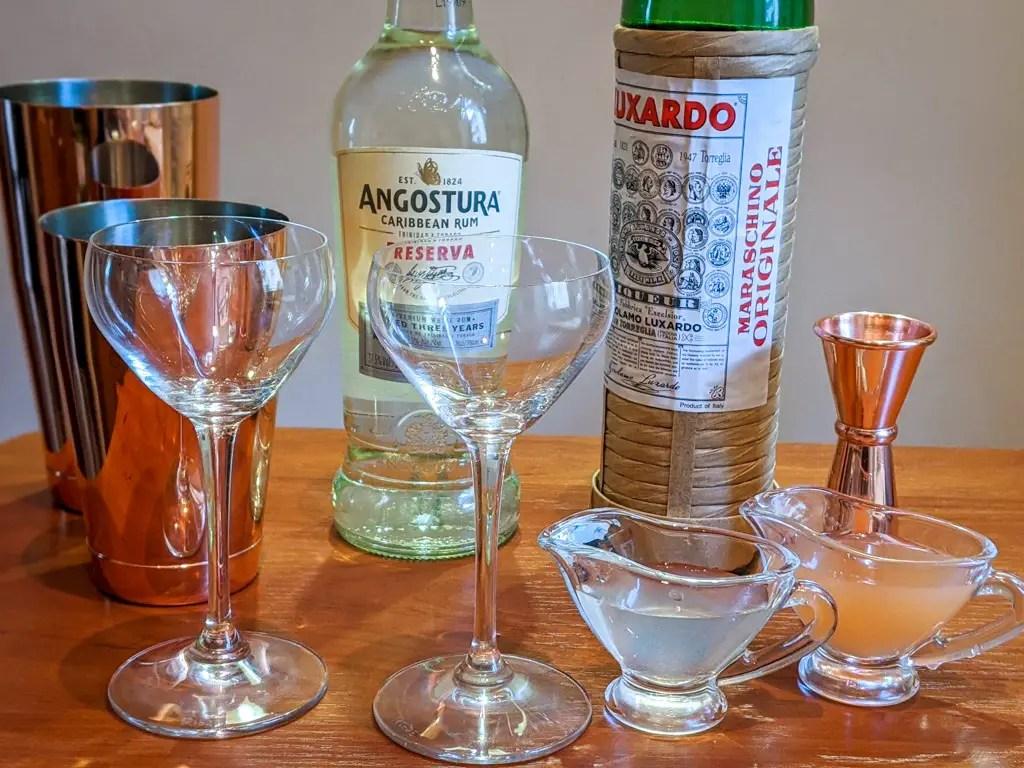 Ingredients (clockwise from back): White Rum, Luxardo Maraschino Liqueur, Grapefruit Juice, Lime Juice
