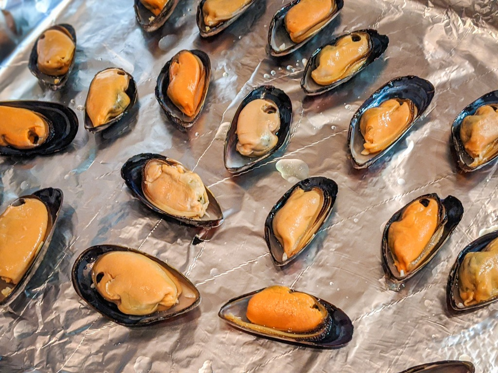 putting the mussel meat back in the shell
