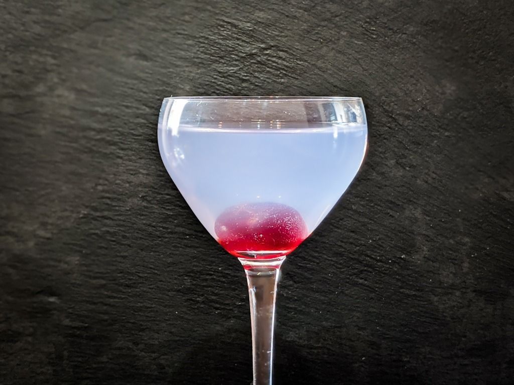 pelagic cocktail that uses butterfly pea flower liqueur