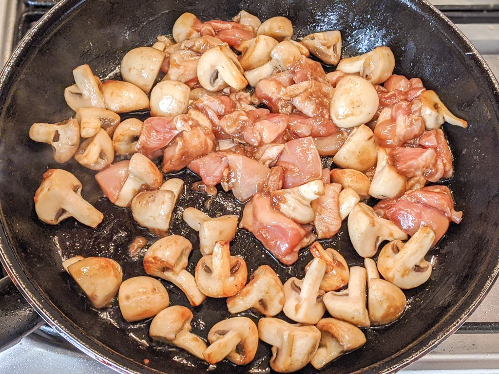 stir frying chicken and mushrooms for the chinese walnut chicken
