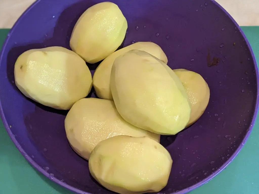 bowl of peeled potatoes