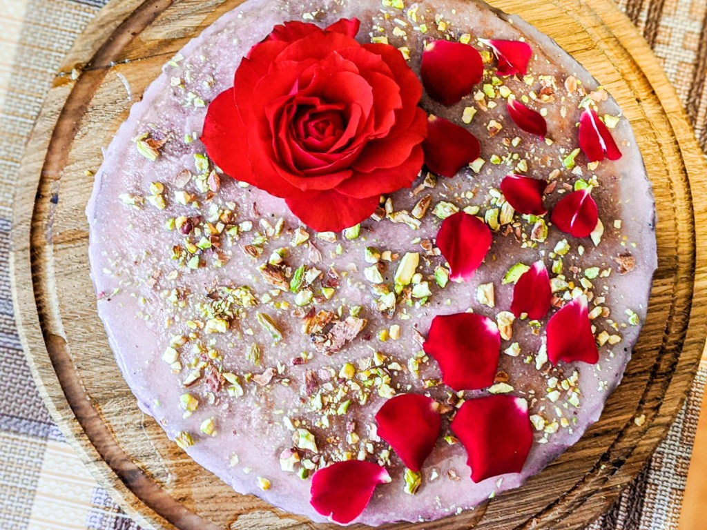Almond Rose Cake with chopped pistachios