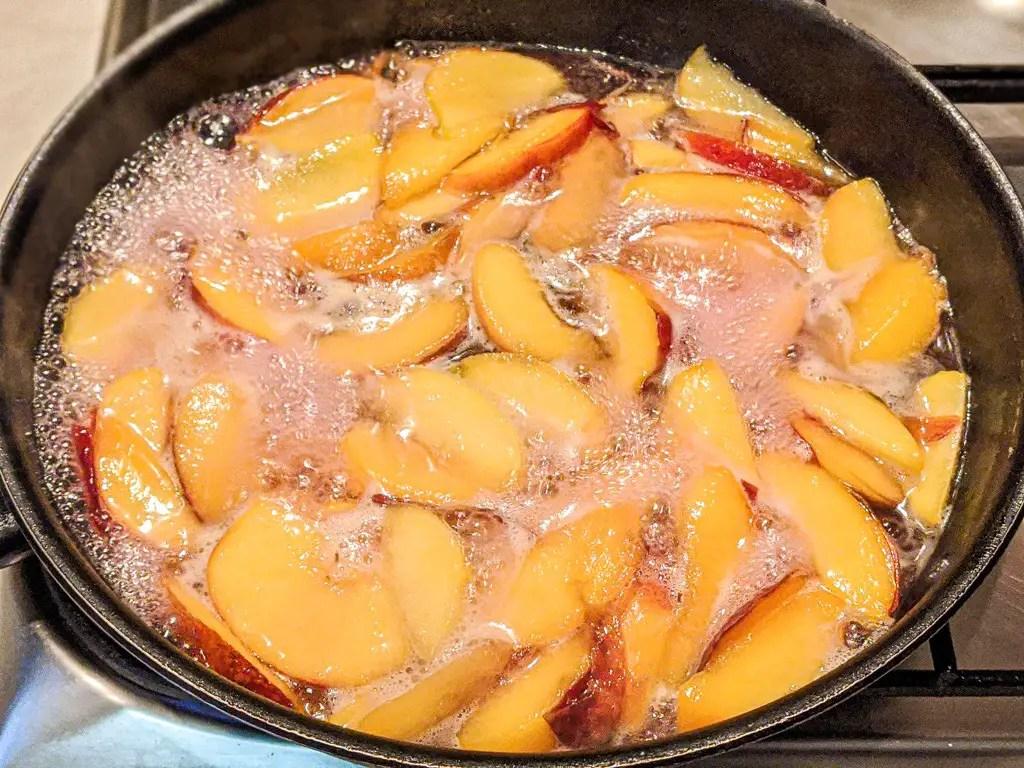 simmering nectarines in sugar water