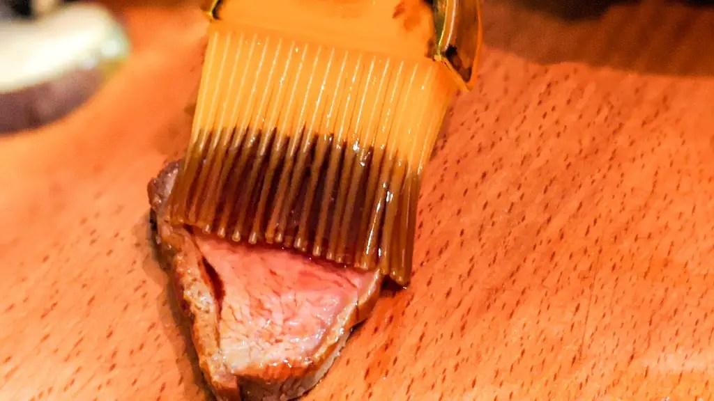 Brushing the yakitori tare over the duck breast