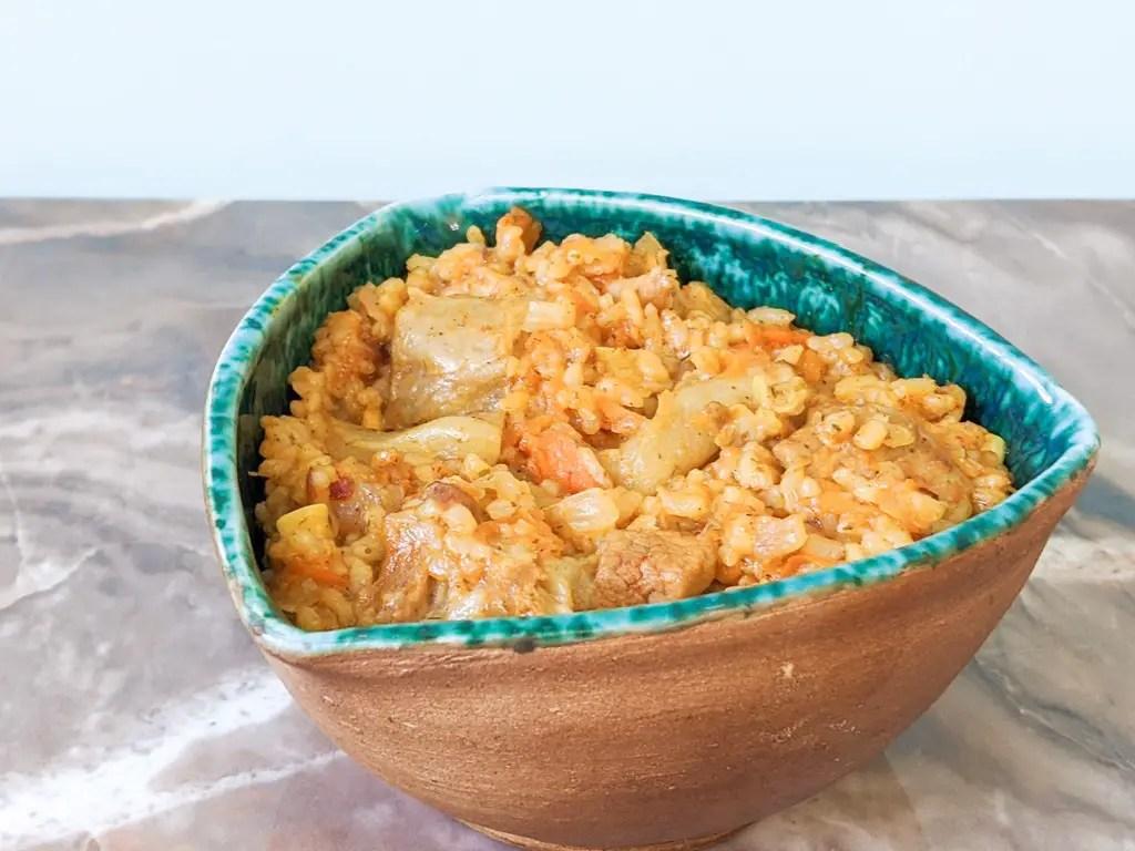 Ukrainian Pork Plov (Rice Pilaf) in a bowl