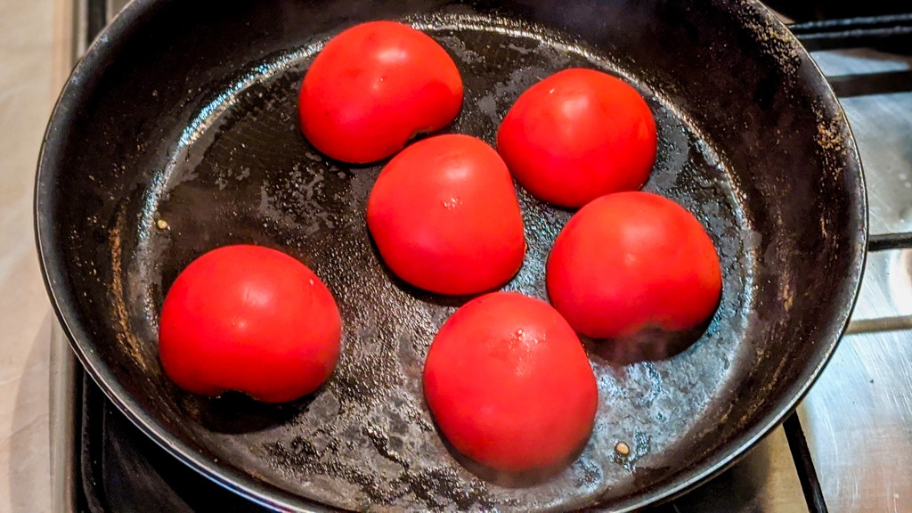 Blackening tomatoes for the birria adobo