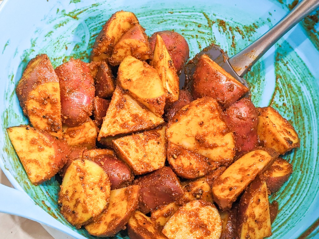 red potatoes tossed in spicy curry powder and olive oil