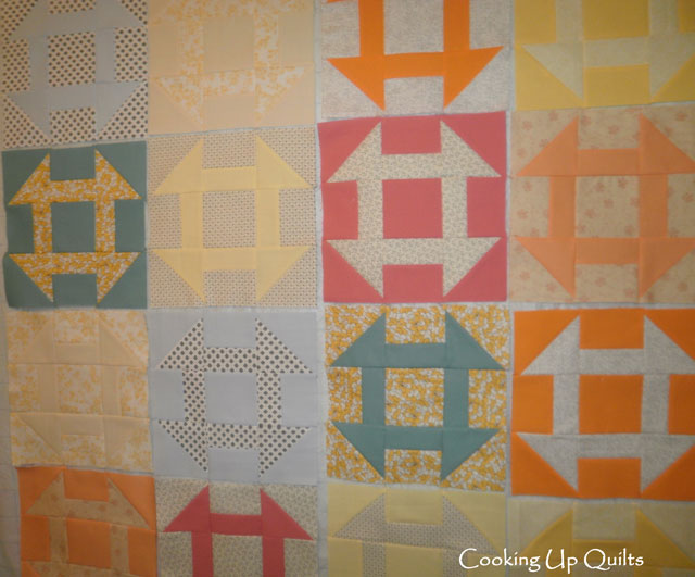 Churn Dash squares on the wall.  Trying to decide about the colors to keep.