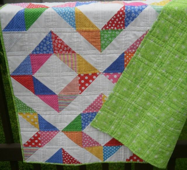 I love the backing fabric.  It adds great personality to the quilt.