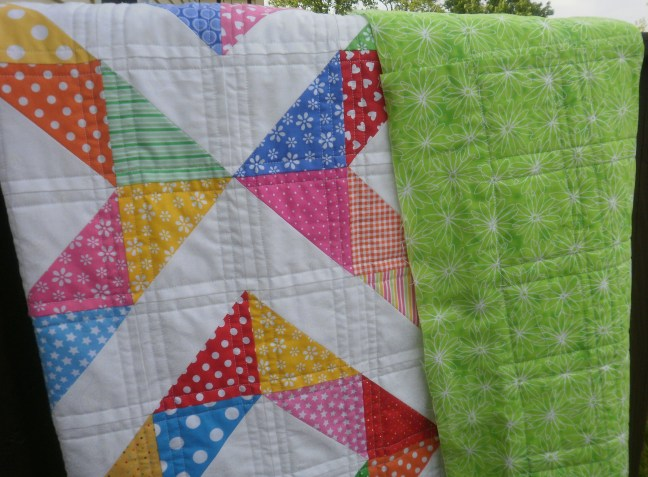 Straight line quilting on front and back.