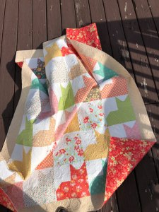 The Wind wins during this quilt photo shoot!