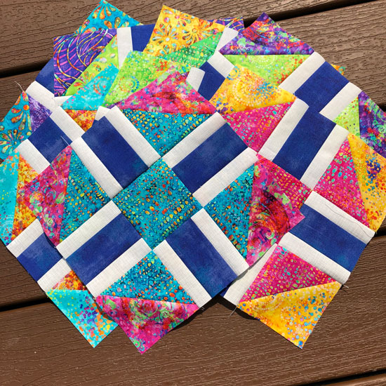 Scrappy Razzle Berry blocks made by Beth Sellers of Cooking Up Quilts