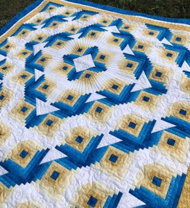 Log cabin quilted by Beth Sellers of Cooking Up Quilts