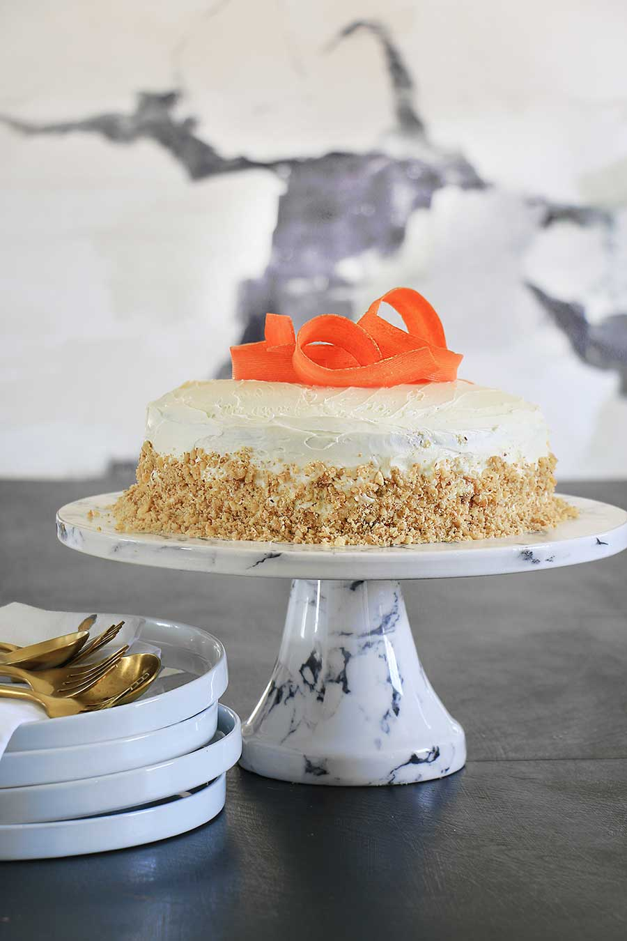 Carrot cake decorated with shaved carrots on top