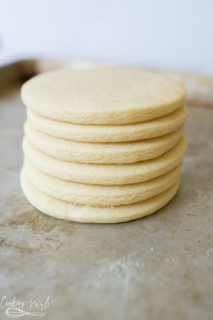 roll and cut sugar cookies, baked and stacked for photo