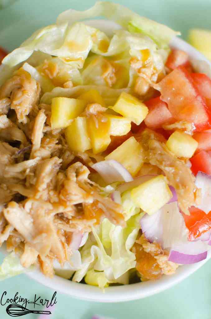 Teriyaki Chicken Chopped Salad consists of crunchy lettuce, warm teriyaki chicken, fresh pineapple and an array of optional toppings. The salad is finished off with a drizzle of homemade teriyaki dressing.