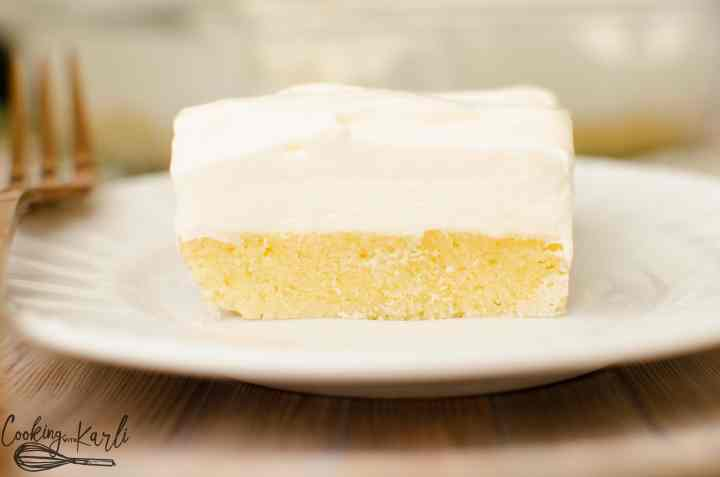 Vanilla Lush Cake is the combination of fluffy topping and a dense sugar cookie crust.