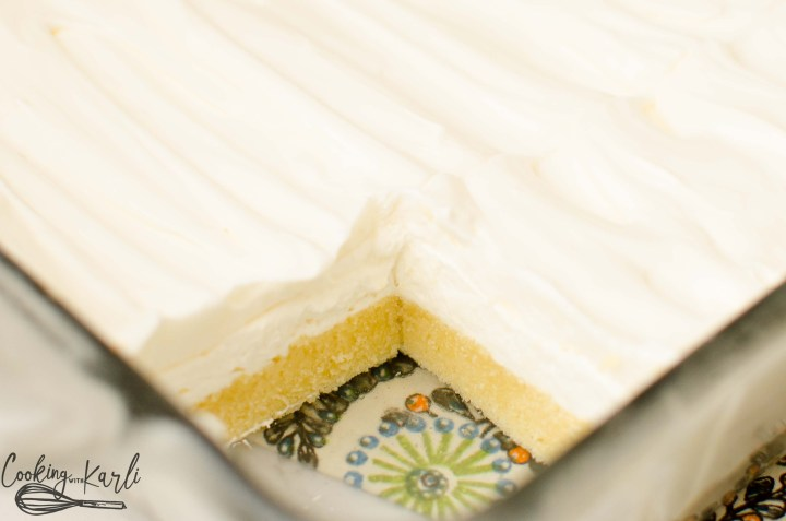 With a sugar cookie crust, cream cheese layer and a vanilla cool whip layer, this lush cake is sure to be a winner!