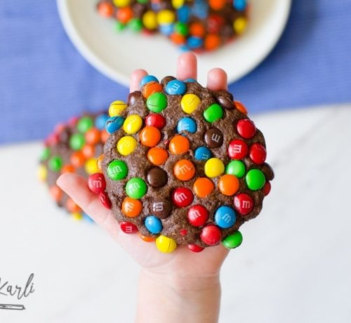Chocolate cookie exploding with M&Ms.