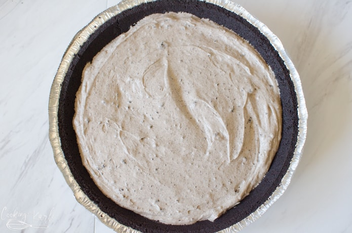 The Oreo pie filling poured into the pie crust.