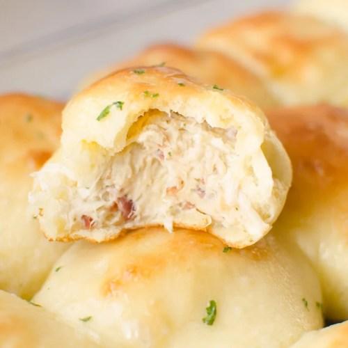 crack chicken baked inside of bread dough