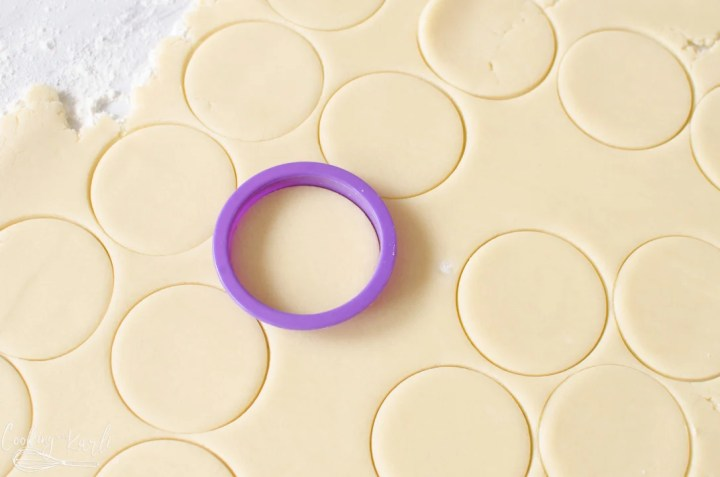 cookies being cut with cookie cutters