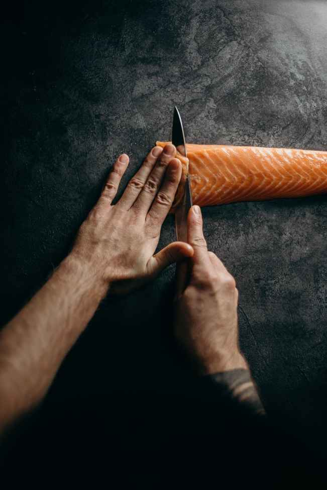 photo of person holding knife