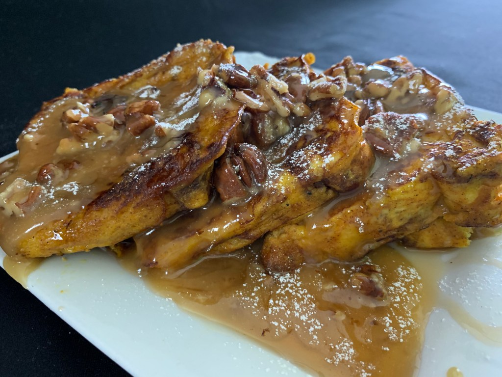 French Toast Infused With Apple Cinnamon Pumpkin And Drizzled With A Warm Decadent Flavorful Pecan Praline Sauce That Makes The Combination Irresistibly Delicious And Satisfying At Any Time Of The Year.