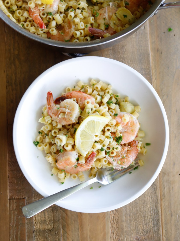 Summer Shrimp Pasta with fresh herbs and ditalini noodles. The perfect pasta dish for a random Monday night or a fun at-home date night paired with chilled white wine!