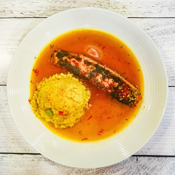 thyme salmon with yellow rice (with peppers and onion) and garlic saffron broth