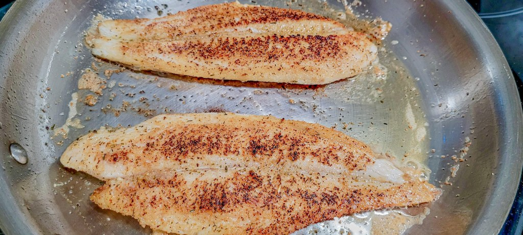 Frying fish on a hot pan